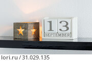 Купить «White block calendar present date 13 and month September on white wall background», фото № 31029135, снято 11 декабря 2017 г. (c) easy Fotostock / Фотобанк Лори