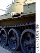 Купить «Parts of the hull of the armored old tank. In front and back of tank stays many different tanks. Parts closeup. Military equipment outdoor open air museum.», фото № 31039199, снято 10 ноября 2018 г. (c) easy Fotostock / Фотобанк Лори
