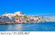 Купить «View buildings in Ribeira District and Bishop's Palace in Porto on Iberian Peninsula», фото № 31039467, снято 17 июля 2018 г. (c) Николай Коржов / Фотобанк Лори