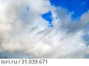 Купить «Sunset colorful sky background - blue dramatic colorful clouds lit by evening sunshine», фото № 31039671, снято 31 августа 2015 г. (c) Зезелина Марина / Фотобанк Лори