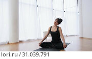 Butterfly posture and neck's stretching made by yoga female couch slow motion. Стоковое видео, видеограф Denis Mishchenko / Фотобанк Лори