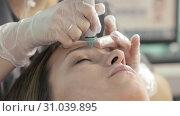 Young woman is relaxing during the vaccum facial hydropeeling procedure in slow motion. Стоковое видео, видеограф Denis Mishchenko / Фотобанк Лори