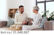 Купить «senior mother talking to adult son at home», видеоролик № 31040067, снято 25 июня 2019 г. (c) Syda Productions / Фотобанк Лори