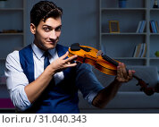 Купить «Young musician man practicing playing violin at home», фото № 31040343, снято 15 августа 2017 г. (c) Elnur / Фотобанк Лори