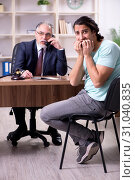Купить «Young man visiting experienced male lawyer», фото № 31040835, снято 23 апреля 2019 г. (c) Elnur / Фотобанк Лори