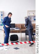Купить «Two experts criminologists working in the office», фото № 31040871, снято 23 апреля 2019 г. (c) Elnur / Фотобанк Лори