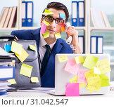Купить «Businessman with reminder notes in multitasking concept», фото № 31042547, снято 26 сентября 2017 г. (c) Elnur / Фотобанк Лори