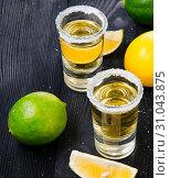 Купить «Tequila drink served in glasses with lime and salt», фото № 31043875, снято 18 сентября 2017 г. (c) Elnur / Фотобанк Лори