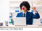 Купить «Young clown businessman working in the office», фото № 31043923, снято 14 декабря 2018 г. (c) Elnur / Фотобанк Лори