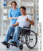 Купить «Patient undergoing rehabilitation recovery programme with doctor», фото № 31044651, снято 18 апреля 2017 г. (c) Elnur / Фотобанк Лори