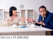 Купить «Male real estate agent and female client in the apartment», фото № 31044843, снято 12 апреля 2019 г. (c) Elnur / Фотобанк Лори