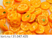 Купить «Tray full of ripe kumquat slices, suitable as background», фото № 31047435, снято 13 ноября 2019 г. (c) easy Fotostock / Фотобанк Лори