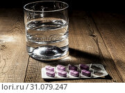 Купить «Whater and pills on table with shadow», фото № 31079247, снято 12 апреля 2016 г. (c) easy Fotostock / Фотобанк Лори