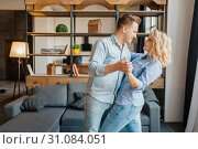 Купить «Young love couple dancing at home, romantic dinner», фото № 31084051, снято 18 апреля 2019 г. (c) Tryapitsyn Sergiy / Фотобанк Лори