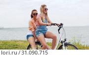 Купить «teenage girls or friends riding bicycle in summer», видеоролик № 31090715, снято 25 июня 2019 г. (c) Syda Productions / Фотобанк Лори
