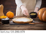 Купить «woman cooks pumpkin pie», фото № 31090979, снято 23 ноября 2018 г. (c) Майя Крученкова / Фотобанк Лори