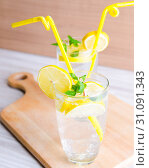 Купить «Glasss of mojito with lemon and drinking straw», фото № 31091343, снято 22 ноября 2017 г. (c) Elnur / Фотобанк Лори