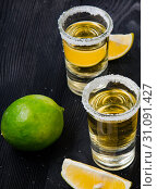 Купить «Tequila drink served in glasses with lime and salt», фото № 31091427, снято 18 сентября 2017 г. (c) Elnur / Фотобанк Лори
