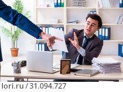 Купить «Young male employee being fired from his work», фото № 31094727, снято 18 февраля 2019 г. (c) Elnur / Фотобанк Лори
