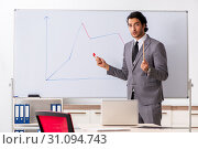 Купить «Young handsome businessman in front of whiteboard», фото № 31094743, снято 10 октября 2018 г. (c) Elnur / Фотобанк Лори