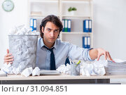 Купить «Businessman rejecting new ideas with lots of papers», фото № 31094851, снято 13 февраля 2019 г. (c) Elnur / Фотобанк Лори