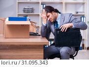 Купить «Young male employee being fired from his work», фото № 31095343, снято 17 апреля 2019 г. (c) Elnur / Фотобанк Лори