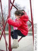 Купить «5 year old girl climbs on an iron structure of the basketball field basket», фото № 31103015, снято 19 января 2013 г. (c) easy Fotostock / Фотобанк Лори