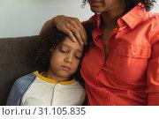 Купить «Mother consoling her son in the lobby at hospital», фото № 31105835, снято 9 марта 2019 г. (c) Wavebreak Media / Фотобанк Лори