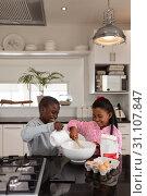 Купить «Siblings preparing food on a worktop in kitchen at home», фото № 31107847, снято 19 марта 2019 г. (c) Wavebreak Media / Фотобанк Лори