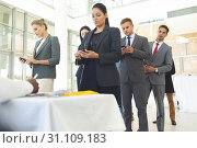 Купить «Group of diverse business people texting on mobile phone while queuing up for interview», фото № 31109183, снято 21 марта 2019 г. (c) Wavebreak Media / Фотобанк Лори