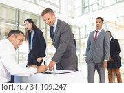 Купить «Group of diverse business people waiting in line for registering », фото № 31109247, снято 21 марта 2019 г. (c) Wavebreak Media / Фотобанк Лори