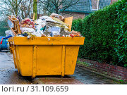 Купить «Massive container full of bulky waste, pile of garbage, recycling concept», фото № 31109659, снято 14 июля 2020 г. (c) easy Fotostock / Фотобанк Лори