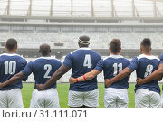 Купить «Group of diverse male rugby players taking pledge together in stadium», фото № 31111071, снято 9 мая 2019 г. (c) Wavebreak Media / Фотобанк Лори