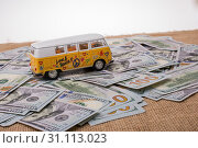 Купить «Model van placed US dollar banknotes spread on ground», фото № 31113023, снято 18 февраля 2017 г. (c) easy Fotostock / Фотобанк Лори
