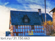 Купить «Historic half-timbered house 'Zum Eichamt' in Zell Mosell directly on the Moselle promenade,», фото № 31150663, снято 26 марта 2016 г. (c) easy Fotostock / Фотобанк Лори