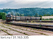 Купить «The locomotive arrives at a small station in Ternopil region, Ukraine. Effect tilt-shifted perspective», фото № 31163335, снято 22 мая 2016 г. (c) easy Fotostock / Фотобанк Лори