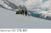 Купить «Young friends set a tent on a mountain - standing outside - a man playing guitar - Dolomites, Italy», видеоролик № 31178491, снято 22 июля 2019 г. (c) Константин Шишкин / Фотобанк Лори