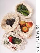 Купить «Zero waste concept. Fresh organic fruits and vegetables in cotton eco bags, flat lay», фото № 31198951, снято 16 апреля 2019 г. (c) easy Fotostock / Фотобанк Лори