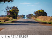 Endless straight road in Australian Outback with hot sun causing Fata Morgana. Стоковое фото, фотограф Maximilian Wollrab / easy Fotostock / Фотобанк Лори