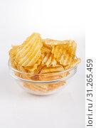 Купить «Glass bowl full with golden spicy potatoe chips on white background», фото № 31265459, снято 7 января 2014 г. (c) easy Fotostock / Фотобанк Лори