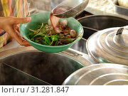Купить «The ladle is drained in a bowl of noodles,Cooking noodle in thailand,the noodles pork and beef.», фото № 31281847, снято 1 апреля 2018 г. (c) easy Fotostock / Фотобанк Лори