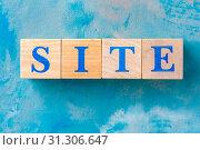 Купить «Wooden cubes with word SITE on blue table.», фото № 31306647, снято 10 апреля 2019 г. (c) Pavel Biryukov / Фотобанк Лори