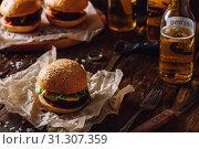 Купить «Homemade Hamburger with Bottle of Beer on Dark Wooden Table.», фото № 31307359, снято 3 марта 2017 г. (c) easy Fotostock / Фотобанк Лори