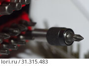 Купить «Bits holder in box and many tool bits on white background. Close-up view. Red element in plastic box.», фото № 31315483, снято 6 августа 2018 г. (c) easy Fotostock / Фотобанк Лори