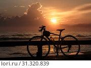 Купить «Bicycles and sunrise scenery in Songkhla province.», фото № 31320839, снято 10 декабря 2017 г. (c) easy Fotostock / Фотобанк Лори