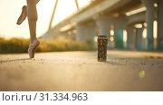 Купить «Young woman ballerina standing on the pointe shoes on sunset - a bottle with drawings standing on the ground», видеоролик № 31334963, снято 27 мая 2020 г. (c) Константин Шишкин / Фотобанк Лори