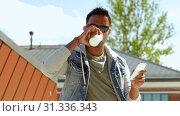 Купить «man with smartphone drinking coffee on roof top», видеоролик № 31336343, снято 30 июня 2019 г. (c) Syda Productions / Фотобанк Лори