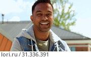 Купить «portrait of smiling indian man on roof top», видеоролик № 31336391, снято 30 июня 2019 г. (c) Syda Productions / Фотобанк Лори