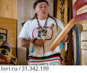 Купить «Native dancers in traditional Haida dancing regalia, Old Masset, Haida Gwaii, British Columbia, Canada, North America», фото № 31342199, снято 6 сентября 2018 г. (c) age Fotostock / Фотобанк Лори