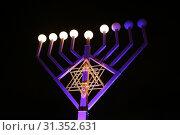 Купить «A Hanukkiah, A Menorah with nine branches», фото № 31352631, снято 16 декабря 2017 г. (c) easy Fotostock / Фотобанк Лори